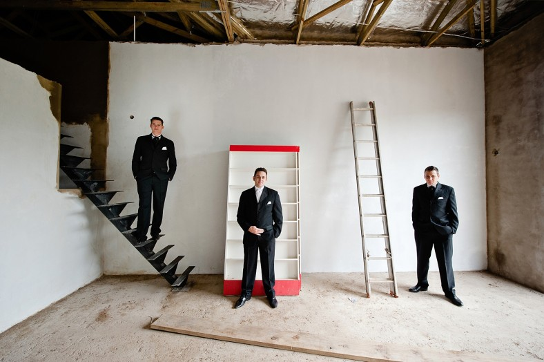 groom and groomsmen in construction site