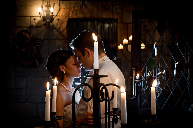 bride and groom with candles