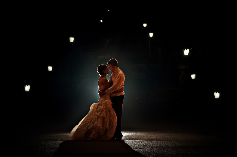 night time portrait of bride and groom