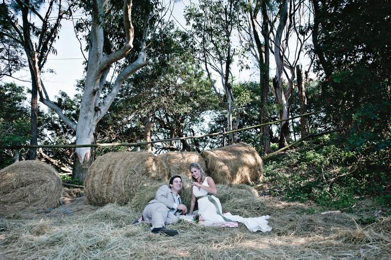 Bride and groom in hay