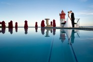 Bride and Groom on Infinity pool at the Oyster Box
