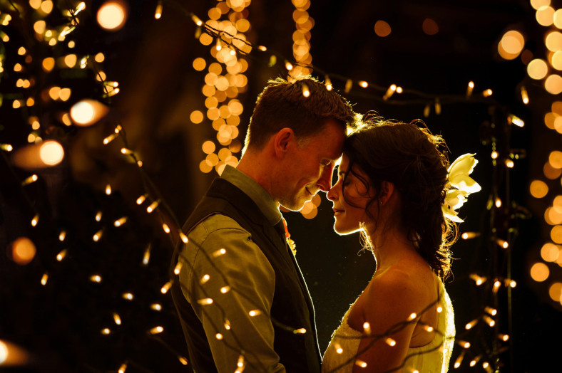 Bride and groom with fairy lights