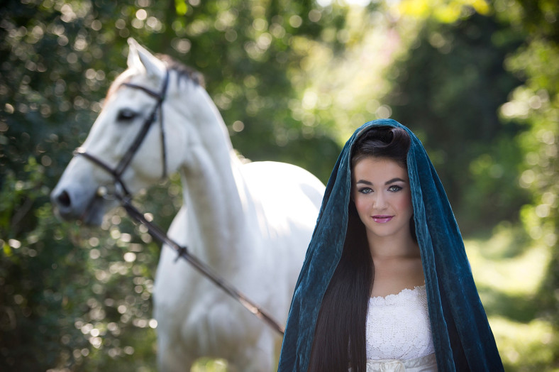 Girl with cape and white horse