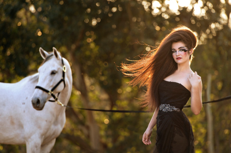 Girl with black Olivelli wedding dress and horse