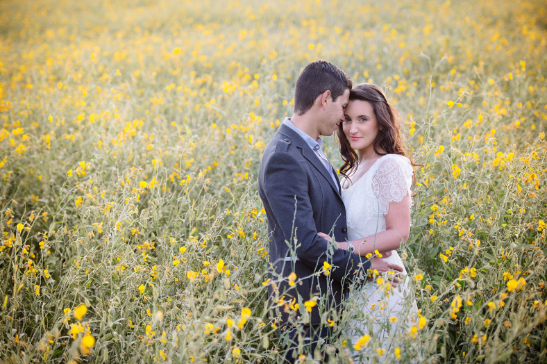 couple in a field of flowers