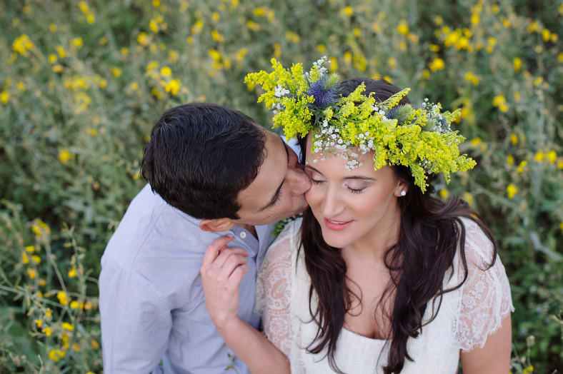 couple kissing with flower crown