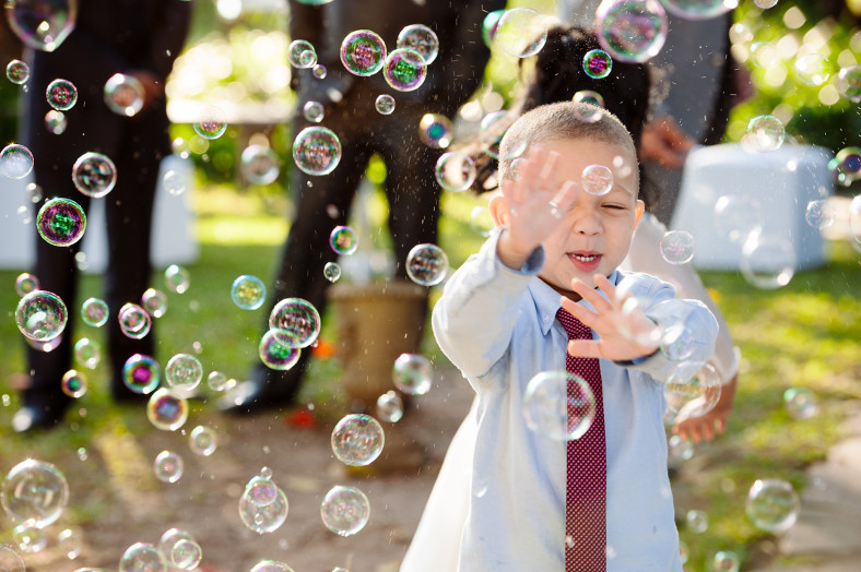 child fighting bubbles