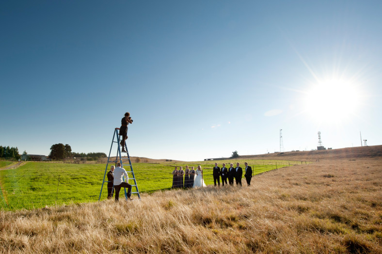 Jacki Bruniquel on ladder taking pictures