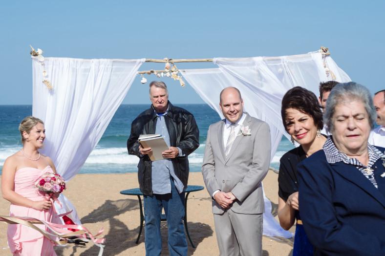 beach wedding groom