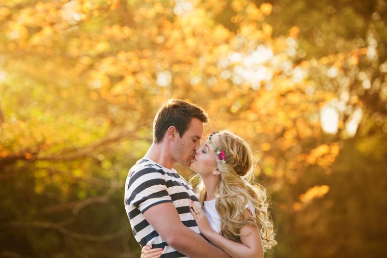 Couple kissing in golden light