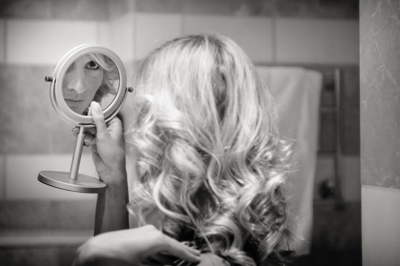 Bridesmaid looking in mirror Wedding at the Oyster Box Hotel Durban South Africa
