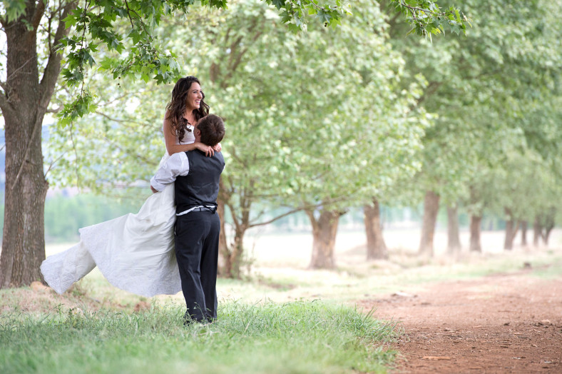 bride and groom in orchard