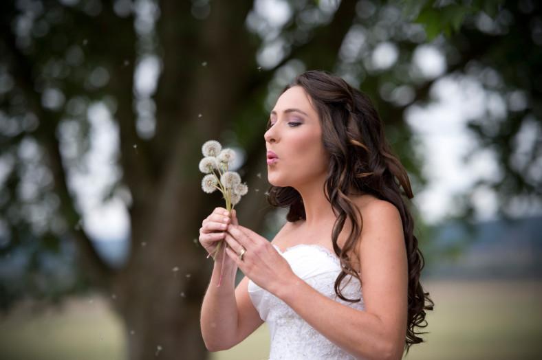 bride blowing dandelions
