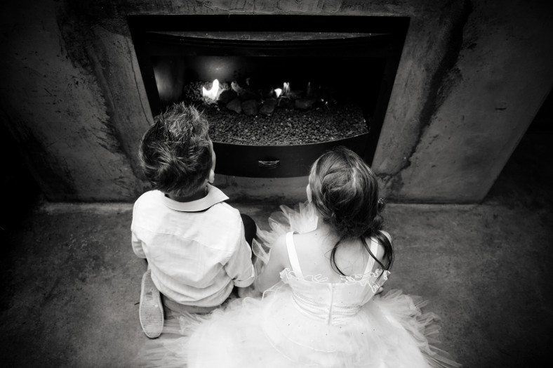 children by a fire place
