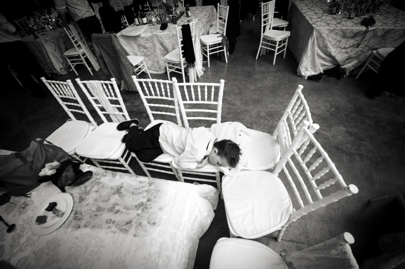 child asleep on chairs
