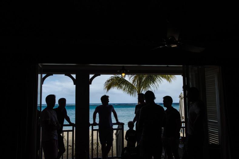 silhouette of groom and groomsmen