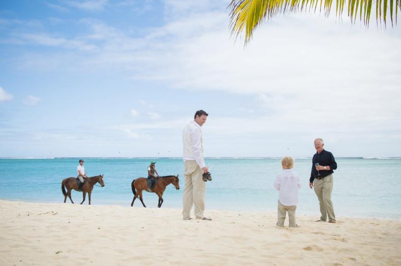 man on beach with horses