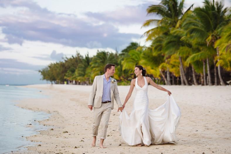 Bride and groom on La Morne beach St Regis