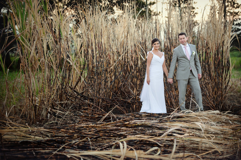 bride and groom in burnt grass