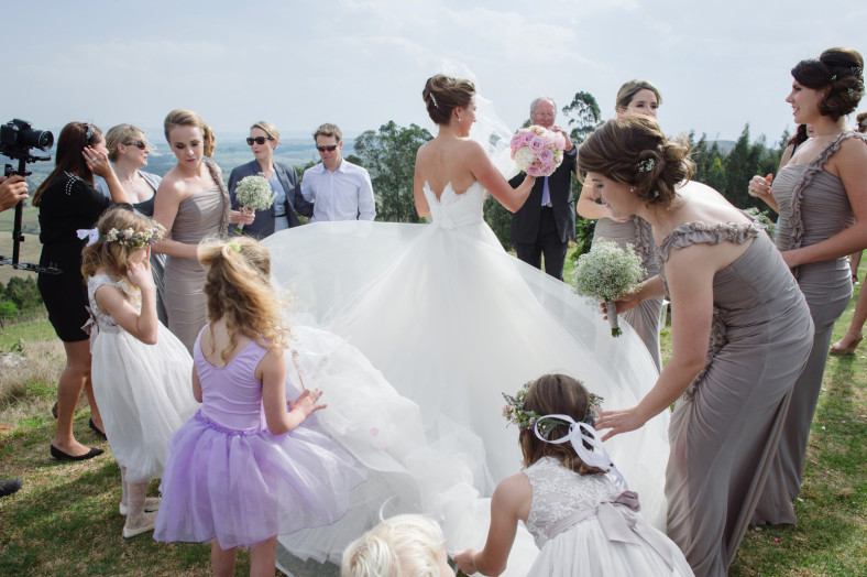 girls fixing wedding dress