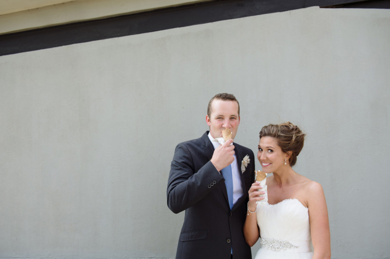 bride and groom eating ice cream