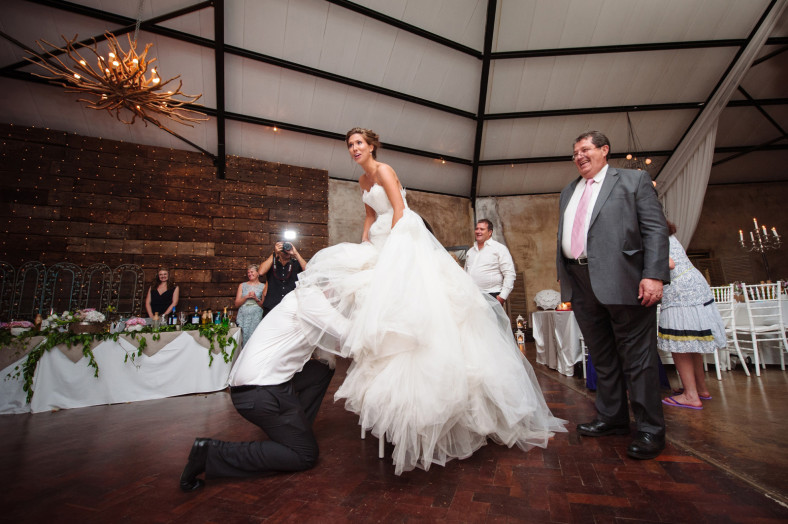 groom searching for garter
