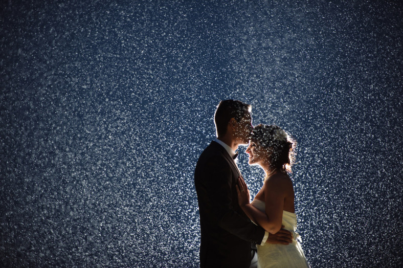 Wedding couple in the rain