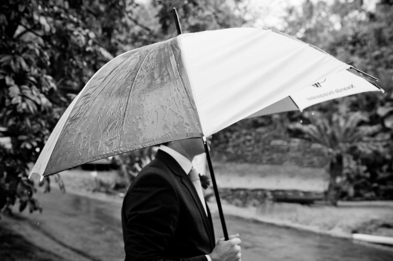 Black and white image of man an umbrella