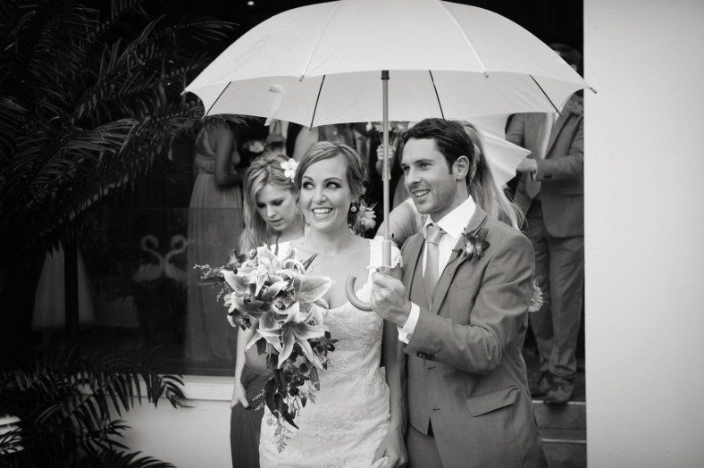 rainy wedding bride and groom
