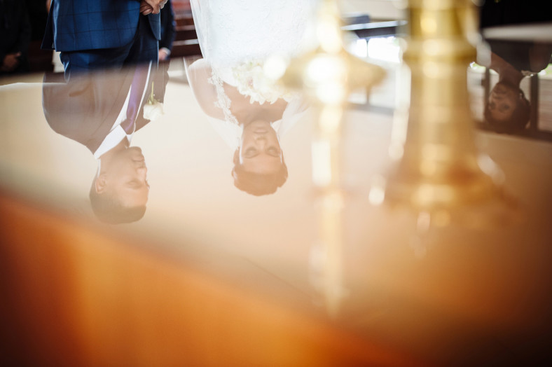bride and groom reflection