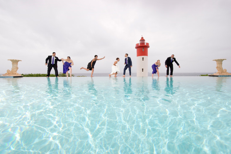 bridal party by swimming pool