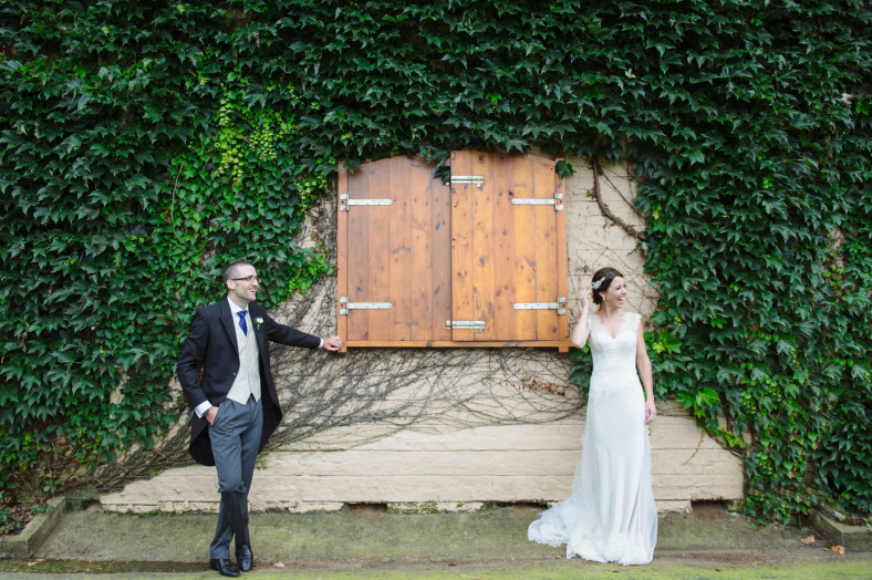bride and groom in stable