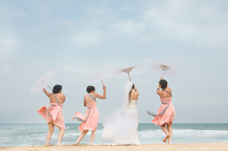 bride and bridesmaids blown away