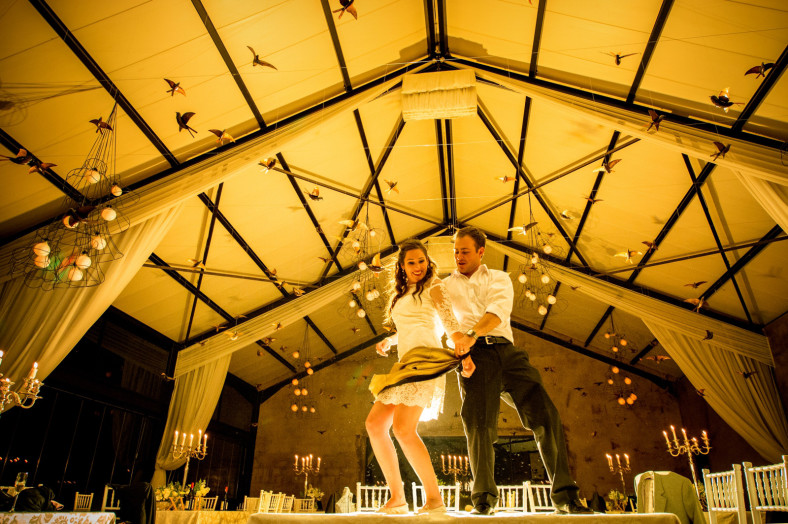 bride and groom dance on tables