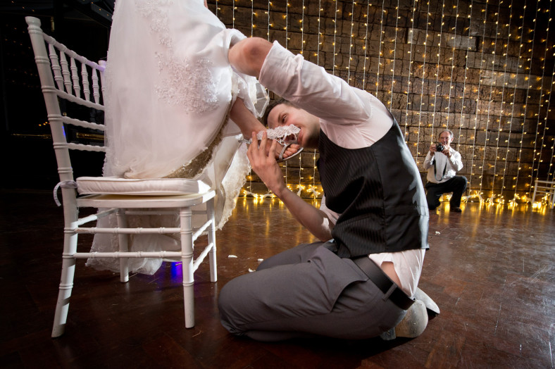 groom biting garter