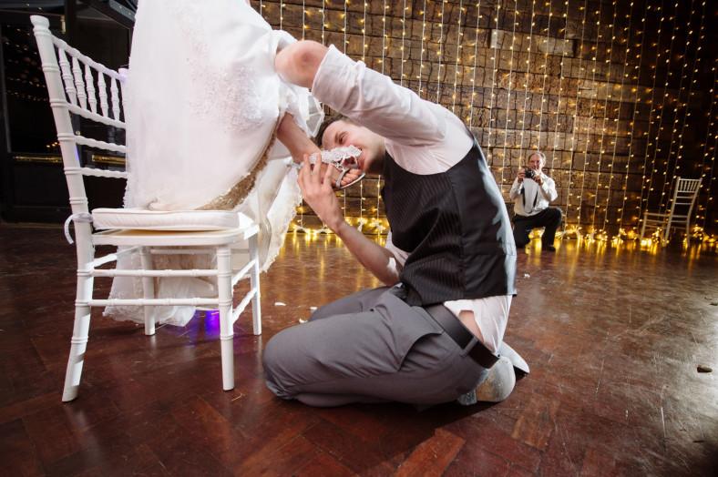 groom biting garter