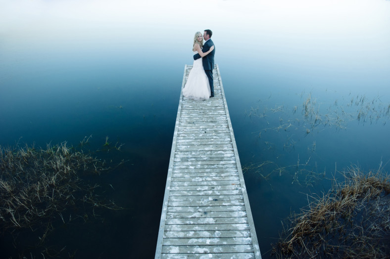 Midlands wedding bride and groom on a jetty