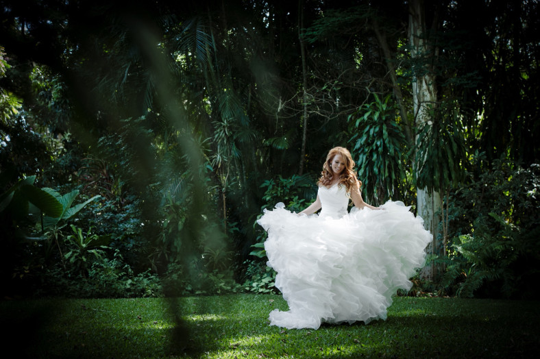 Bride twirling in garden