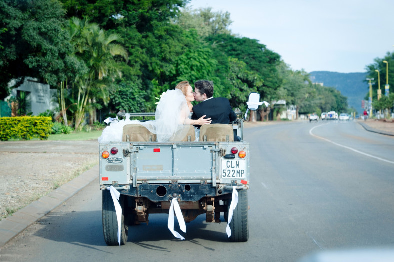 Bride and Groom in a land rover