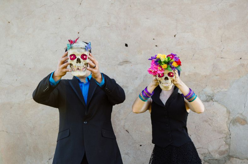 Bride and groom with skulls