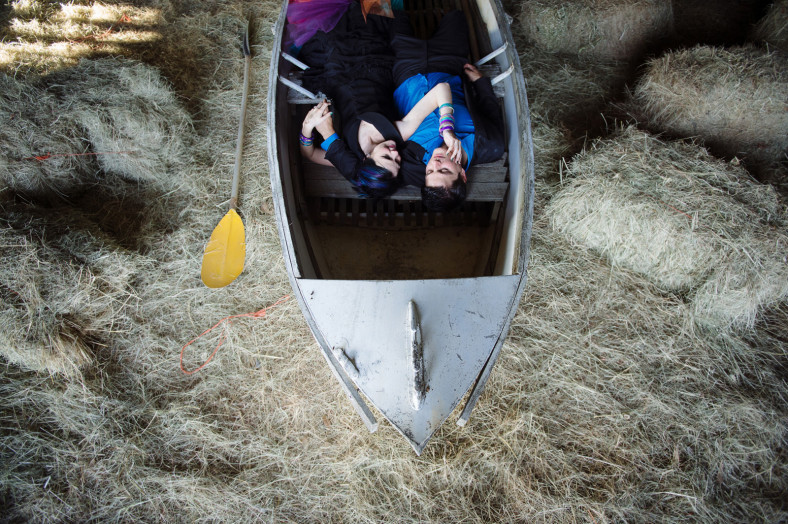 bride and groom in a boat in a barn