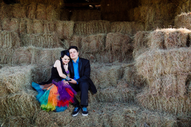 bride and groom on hay