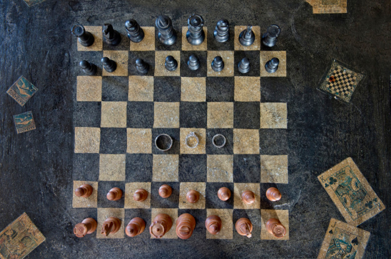Wedding rings on a chess board