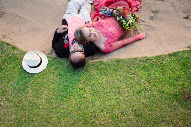 bride and groom in sand pit