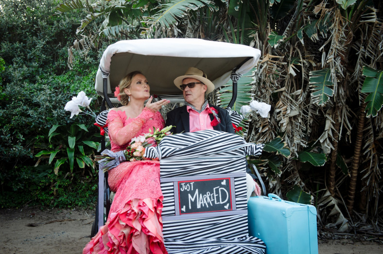 bride and groom leave on golf cart