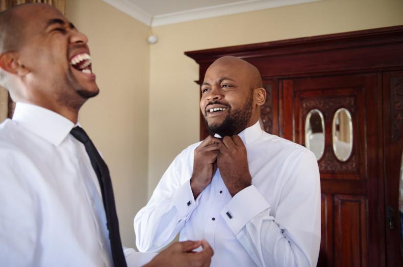 groom and laughing groomsmen