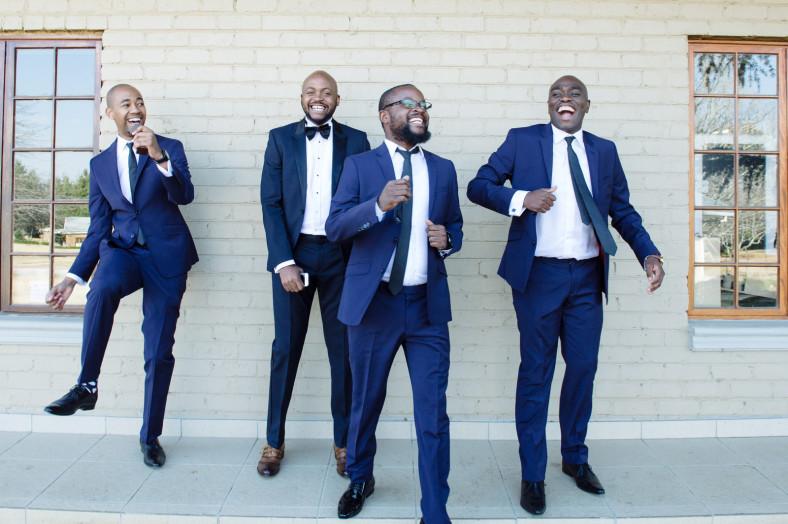 groom and groomsmen dancing