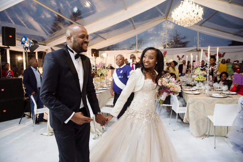 couple entering wedding reception