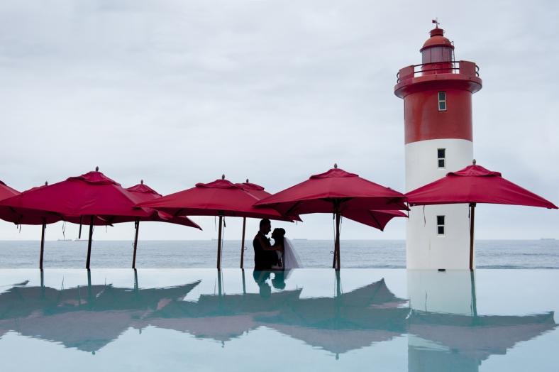 under red umbrellas