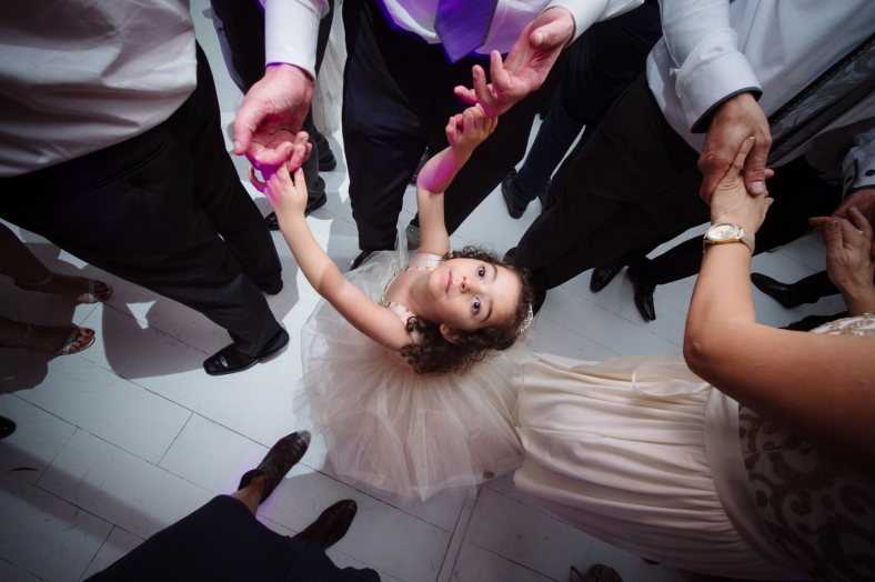 Girl dances at wedding